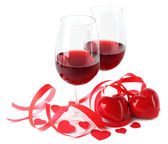 Composition with red wine in glasses, red roses, ribbon and decorative hearts isolated on white — Stockfoto