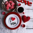 Cookie in form of heart on plate with inscription I Love You on color wooden table background — Stock Photo #63470289
