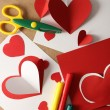 Beautiful hand made post cards, pens and scissors  with paper hearts on color wooden background — Stock Photo #63471553