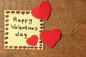 Valentines day notes on wooden background — Stockfoto