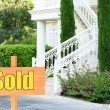 Sold home for sale Real estate sign in front of new house — Stock Photo #63529493
