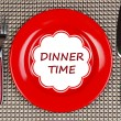 Plate with text Dinner Time, fork and knife on tablecloth background — Photo #63529597