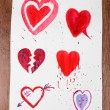 Painted hearts on sheet of paper — Stock Photo #63530993