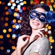Beautiful girl with masquerade mask on bright background — Stock Photo #63531315