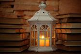 Books and decorative lantern — Stock Photo