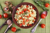 Rice with walnuts  in plate — Stock Photo