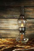 Kerosene lamp with hay — Stock Photo