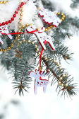 Covered with snow and Christmas decoration branch of spruce, outdoors — Stock Photo