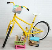 Bicycle with books — Stock Photo