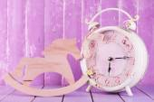 Beautiful vintage clock with decorative horse on table on wooden background — Stock Photo