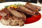 Steak on plate on table — Stock Photo