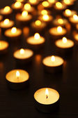 Burning candles on dark — Stock Photo