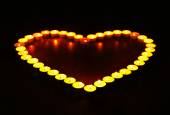 Burning candles in shape of heart — Stock Photo