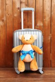 Suitcase with teddy bear — Stock Photo