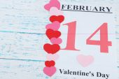 Valentines Day, February 14 on calendar on wooden background — Stock Photo