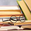 Composition with glasses and books, on table, on light background — Stock Photo #63674179