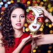 Beautiful girl with masquerade mask on bright background — Stock Photo #63676219
