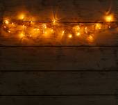 Christmas lights on wooden background — Stock Photo