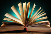 Open book over dark colorful background — Stock Photo