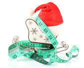 Measuring tape with Christmas decoration — Stock Photo