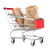 用纸包上白色孤立的小购物车 — 图库照片