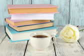 Cup of tea with books on wooden background — Stock Photo