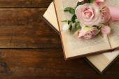 Books with flowers on wooden background — Foto Stock