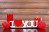 Romantic gift with candles — Stock Photo