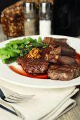 Steak with wine sauce — Stock Photo