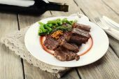 Steak with bottle of wine — Stock Photo