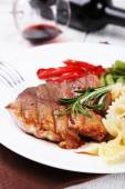 Steak with vegetables and pasta — Stock Photo