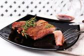 Steak with herbs — Stock Photo