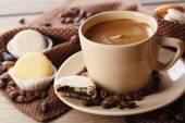 Macaroons and coffee in mug — Stock Photo