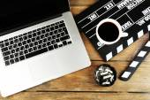 Movie clapper with laptop and coffee — Stock Photo