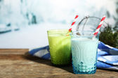 Fresh milk with natural decor, on wooden table, on winter background — Stok fotoğraf