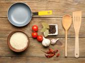 Food ingredients and kitchen utensils for cooking on wooden background — Stock Photo