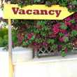 Signboard with text Vacancy near hotel — Stock Photo #63768201