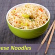 Chinese noodles in bowl on bamboo mat and space for your text — Stock Photo #63768727