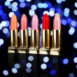 Set of lipsticks on bright colorful background — Stock Photo #63768781