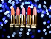 Set of lipsticks on bright colorful background — Stock Photo