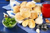 Fresh homemade bread buns from yeast dough with fresh garlic and dill, on wooden background — Stock Photo