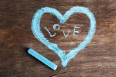 Heart drawn of chalk on wooden background close-up — Stock Photo