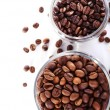 Coffee beans in glass jars isolated on white — Stock Photo #63954811