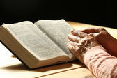 Old woman hands with Bible — Stock Photo