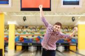 Young man have fun in bowling club — Stock Photo