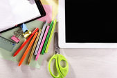 Tablet PC with office supplies — Stock Photo