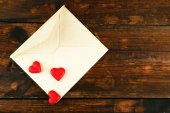 Empty envelope with hearts on rustic wooden table background — Stock Photo