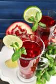 Pomegranate drink in glasses — Stock Photo