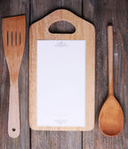 Cutting board with menu paper — Stock Photo