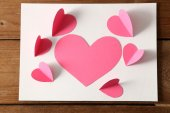 Post card with paper hearts — Stockfoto